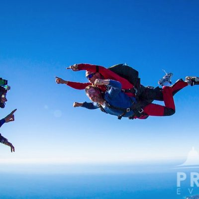 Skydiver filming a skydiving tandem above Prague