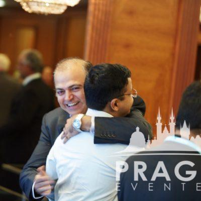 Two men hugging at Inter-Disciplinary conference at Lindner Hotel Prague