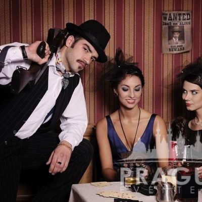 Man and two women dressed as gangsters at Gangster themed party