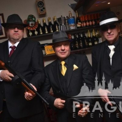Men dressed as gangsters at Gangster themed party in Prague