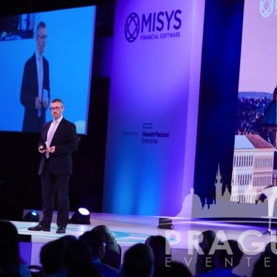 Man speaking in front of an audience at Misys event in Prague