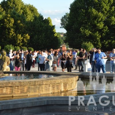 People standing next to fountain at Troja Chateau Garden