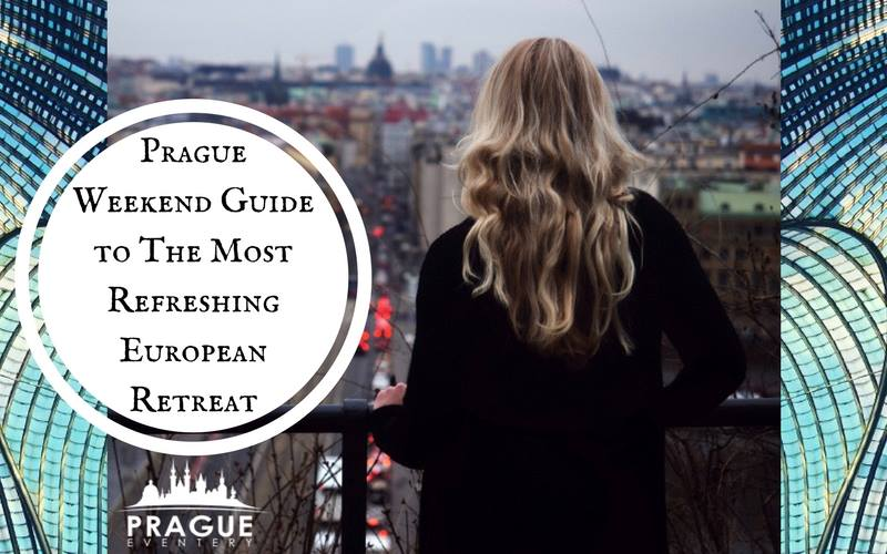 Blonde girl standing on the balcony watching the streets of Prague